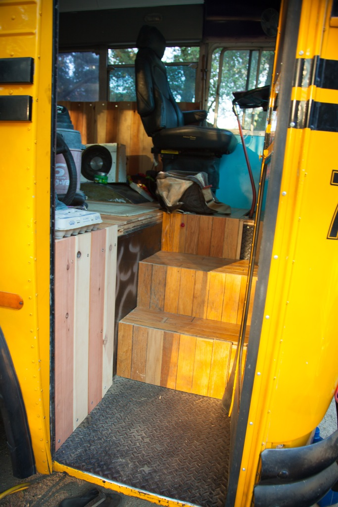 Reclaimed Oak Hardwood covers the entry-way onboard the bus now.  These beautiful floors were given to us after being taken out of a local home.