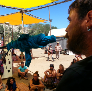 Sean dropping Micro Home Knowledge on the Dreamer's Outpost Stage in Nomad's Nook during Seismic Awakening's Presentation at Lucidity Festival Kindred Quest